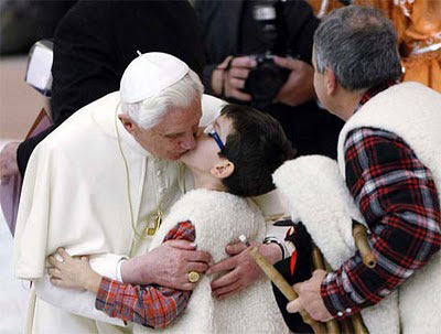 Pope kisses boy on lips
